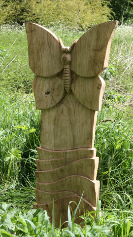 Anthony Hammond carved butterfly on the Dane meadows arts trail, Cheshire.