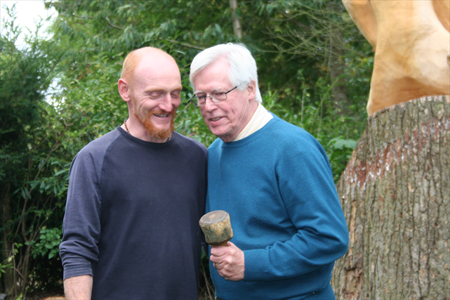 Anthony Hammond teaching TV presenter John craven how to carve