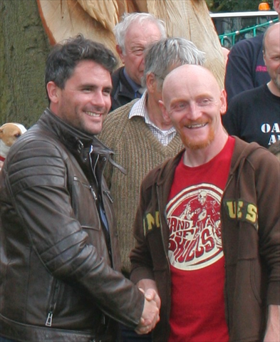 Anthony Hammond and Levison Wood unveiling a public art carving.