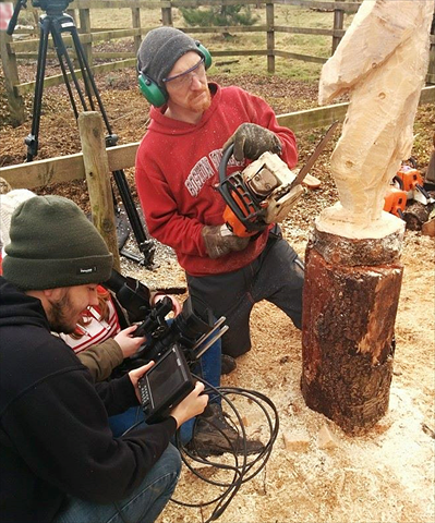 Anthony Hammond carving with film crew